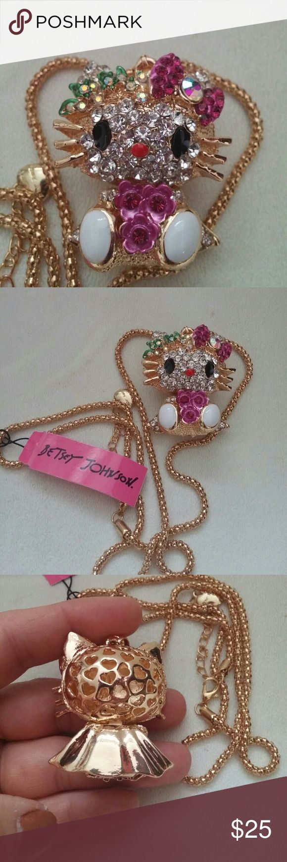 (HELLO MISS KITTY) (JERSEY JOHNSON) necklace Gold hinged Miss Kitty hanging off of a gold rope chain necklace with safety catch that has  heart on bottomof it.  Miss Kitty is all decked out in colorful rhinestones these are simply gorgeous live and best of all new with tags Betsey Johnson Jewelry Necklaces