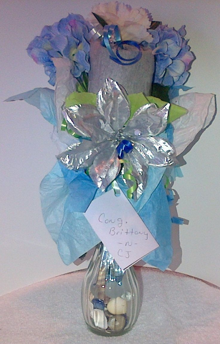 Front of a Small Onesie Bouquet that I did for my Daughter-n-law who's having a Baby Shower on Nov.14, 2015. This Bouquet contain's 2 Onesies for the Baby.