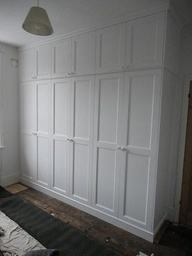 built-in closets that look like wall paneling
