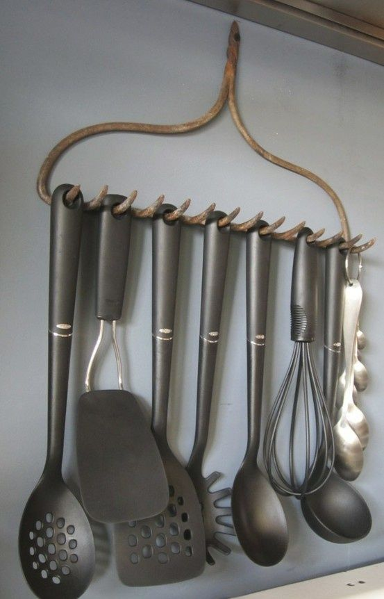 Neat organizational idea! An old rake turned into utensil rack. Would look great in your kitchen...& keep them off the counter. I think a little crafty enhancement is due for it to hang in my kitchen ;)