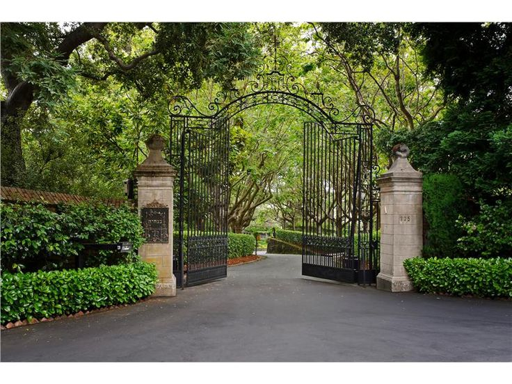 beautiful entry gate and landscaping
