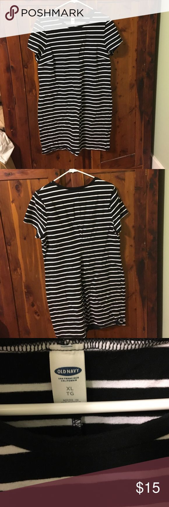 Black and white striped dress Old navy striped dress. The fabric has a little stretch to it. Very flattering and VERY comfortable. Never been worn. The last photo is the same dress in black, just for a fit reference. Old Navy Dresses