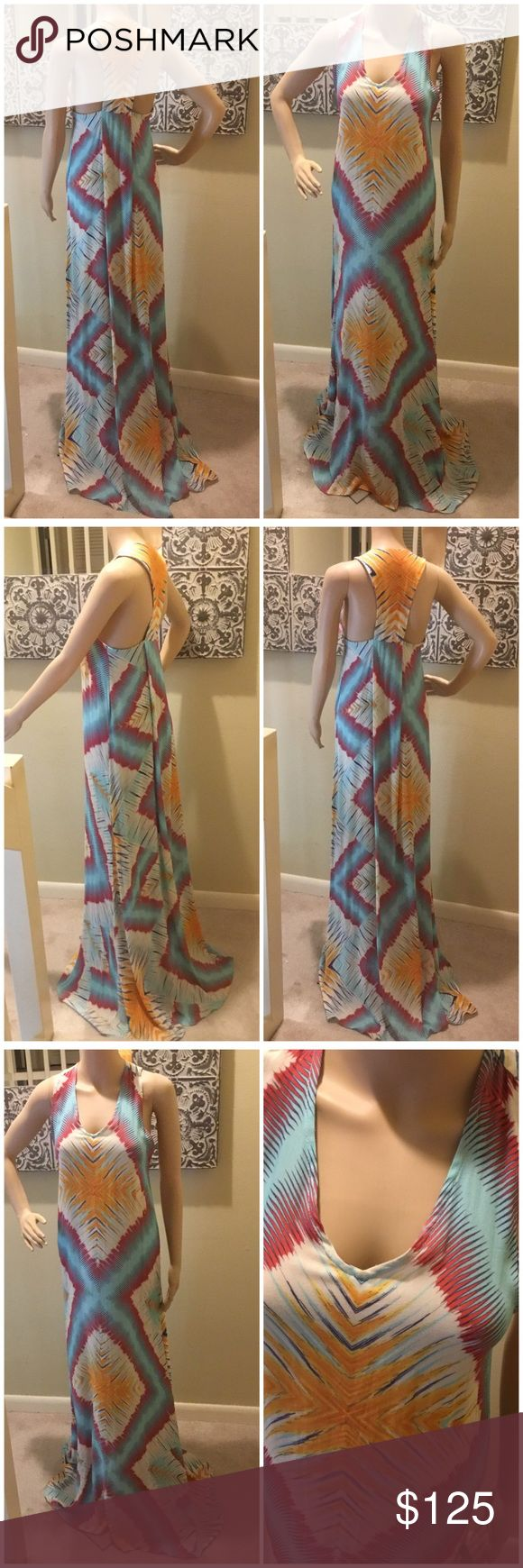 Alexis Small Maxi Dress Diamond shaped pattern with broad swaths of gold and purple.  Other colors in dress are light blue, dark blue, orange and white.  100% viscose. Excellent condition.  Great for the beach, vacation, cruise, summer party or just every day wear. Alexis Dresses Maxi