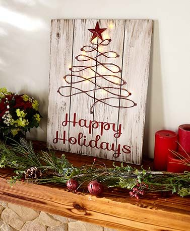 This Lighted Rustic Holiday Sign combines country charm with traditional style. It features Christmas tree inspired artwork with warm white fairy lights through