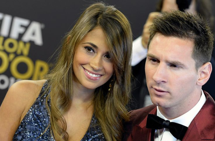 Soccer player Lionel Messi, right, of Argentina arrives with his wife Antonella, left, on the red carpet prior to the FIFA Ballon d'Or 2013 ...