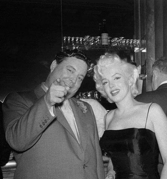 Marilyn Monroe with Jackie Gleason at his birthday party at Toots Shor's, NYC, February 26th 1955.
