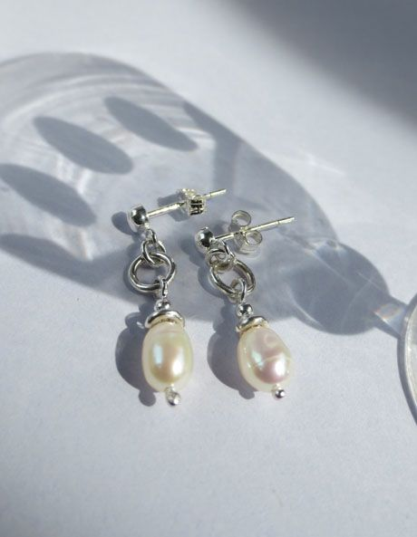 Did it end? Small pearl earrings with studs.