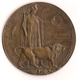 """The Memorial Plaque was issued after the First World War to the next-of-kin of all British and Empire service personnel who were killed as a result of the war. The plaques (more strictly described as plaquettes) were made of bronze, and hence popularly known as the """"Dead Man's Penny"""", because of the similarity in appearance to the somewhat smaller penny coin."""
