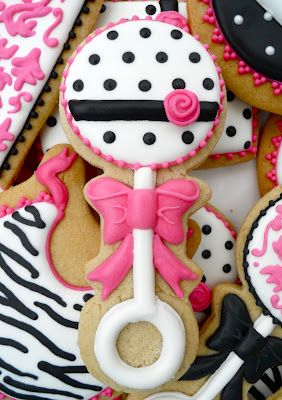 Baby girl rattle decorated cookie for baby shower ~ hot pink, black, and white.