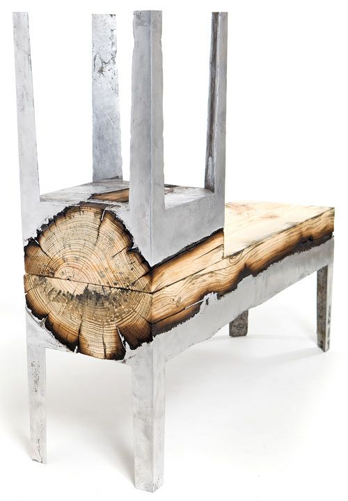 Israeli designer Hilla Shamia uniquely joins the materials of aluminum and wood in this Wood Casting series. Using a whole tree trunk, Shamia pours molten aluminum directly onto the wood, which burns the surface and darkens the wood. The wood gets cut up lengthwise and put into a mold to form the frame and legs of the piece.