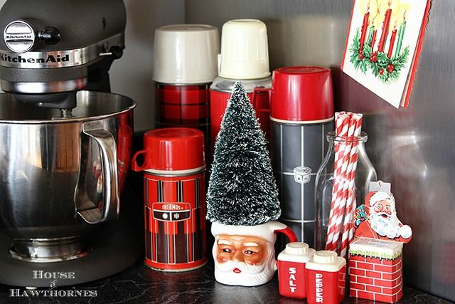 Thermos collection vignette for the holidays complete with Santa mug and a bottle brush tree