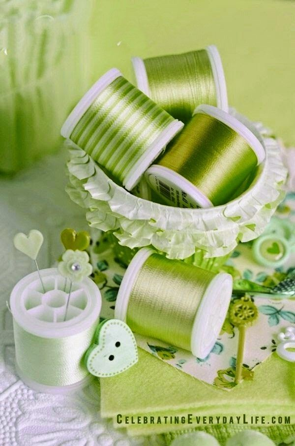 Green toned cotton reels