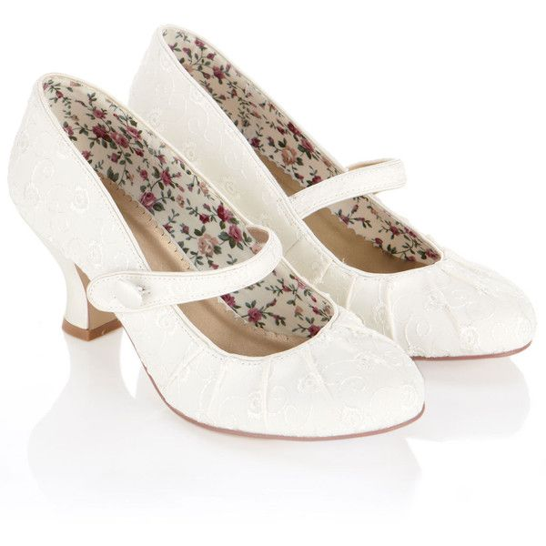These vintage-inspired bridal shoes are designed in a classic Mary Jane style shape, with a button-up strap at the front of the shoe and a low, gently curved h…