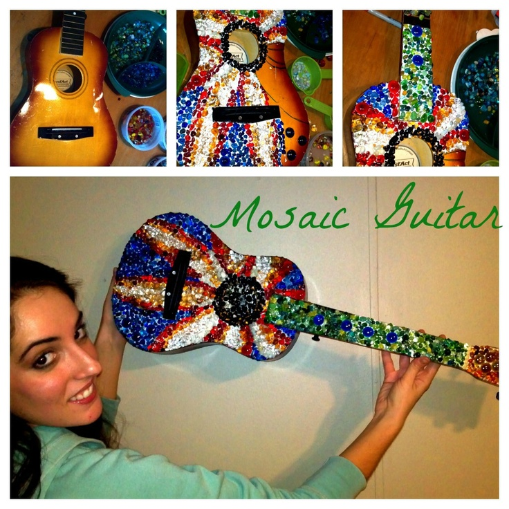 MOSAIC GUITAR .... using simply craft glue, aquarium rocks and other glass rocks. I bought the baby guitar at the goodwill for 5 dollars and I had the glue and some rocks in my collection but bought about 10 dollars worth.