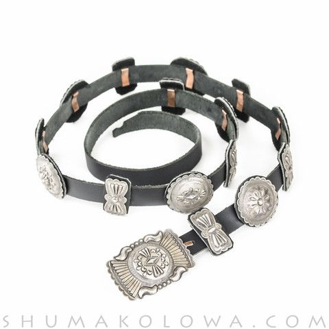 Concho belt handcrafted by Navajo silversmith Christine Whiteth featuring round and butterfly conchos of sterling silver