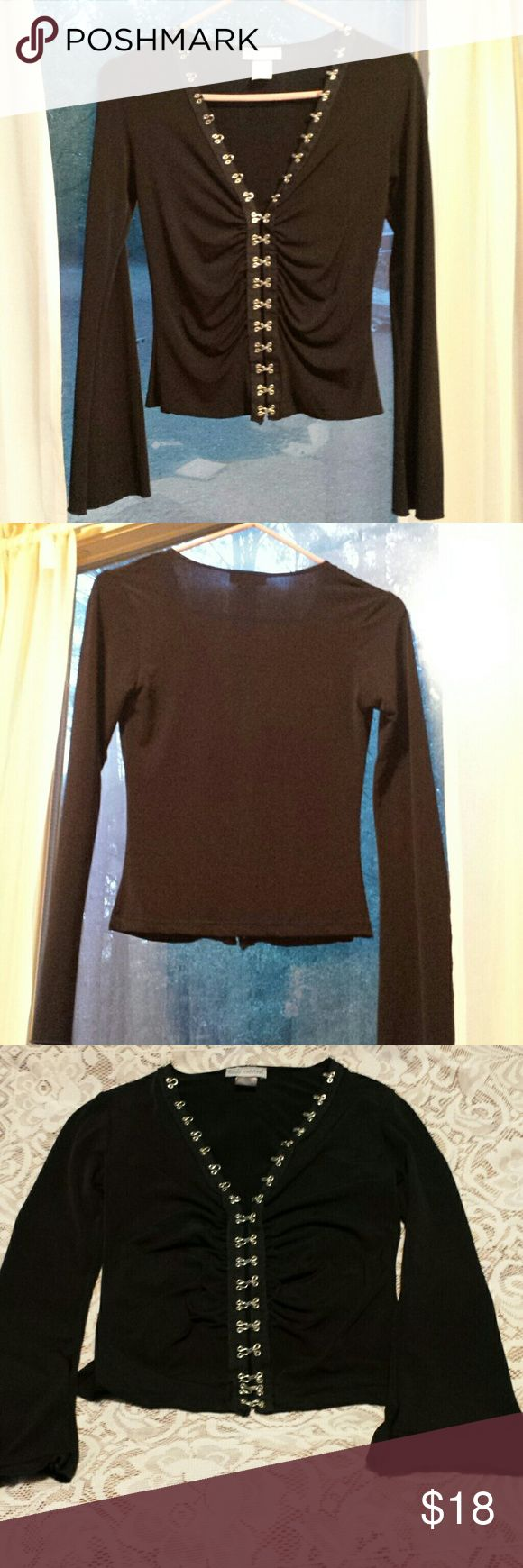 Sexy Black Blouse by Body Central. Size Small Black long sleeved blouse with silver accents by Body Central. Sexy and cute. In excellent pre-loved condition. Hand washed and air dried. 92% Polyester, 8% Spandex. Size Small. Body Central Tops Blouses