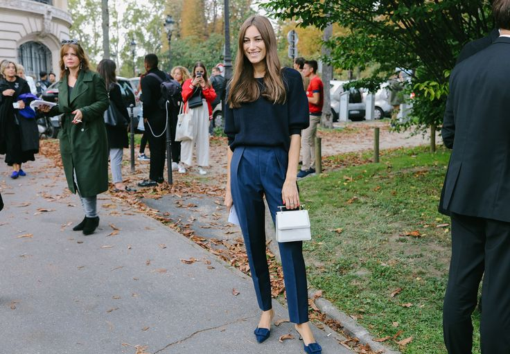 Giorgia Tordini in Manolo Blahnik shoes with an M2Malletier purse