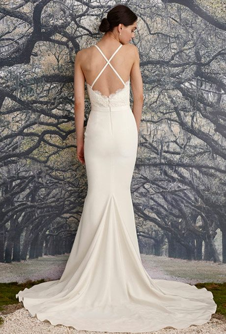 Brides: Nicole Miller. Trumpet gown with a beaded, corded scalloped lace bodice and simple waistband. Scalloped deep-V front and back neckline with scalloped lace details. Crisscross back straps and fishtail train.