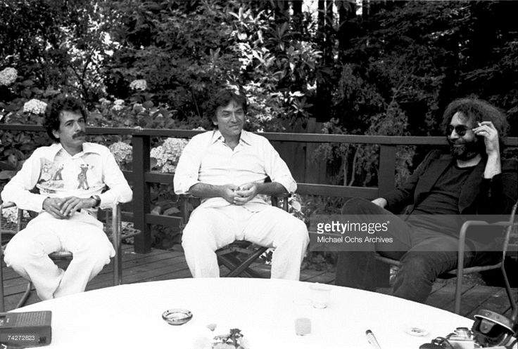 Musicians Jerry Garcia and Carlos Santana with promoter Bill Graham pose for a portrait in 1976 in Mill Valley, California.