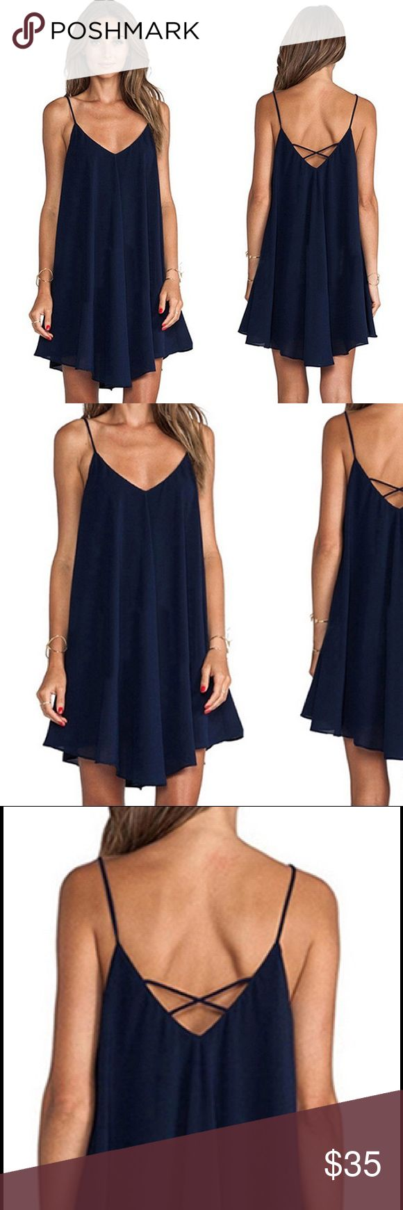 """New❗️""""Julia"""" ll Navy Chiffon Criss-Cross Dress  The """"Julia"""" dress is a navy-colored chiffon spaghetti strap dress. Adorable cross-cross back. Scoop-neck front. As the last photo shows, the dress is lined up until mid thigh for a little added sexiness. This is a dress sure to flatter any body type.  Dresses Midi"""