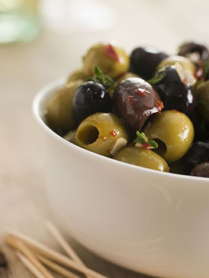 A big dish of marinated olives will transport you to the beautiful Mediterranean. Just imagine sitting in the shade, looking over the blue s...