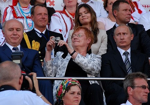 Finno-Ugric National Culture Festival.  I LOVE this photo.  How often do you see the president of a country (sitting next to the president of a major world power) taking her own photos using a relatively unsophisticated camera?