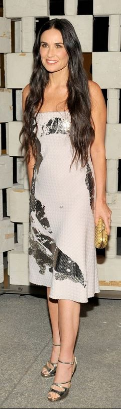 Who made  Demi Moore�s gold sandals, clutch handbag and dress that she wore in Los Angeles on October 11, 2014