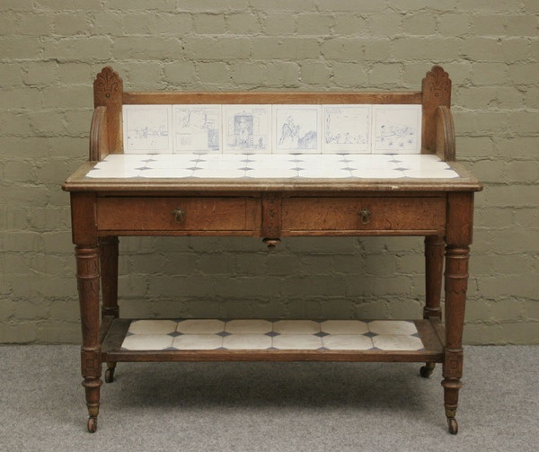 An arts and crafts oak washstand with painted caricature tile back #tile #artsandcrafts