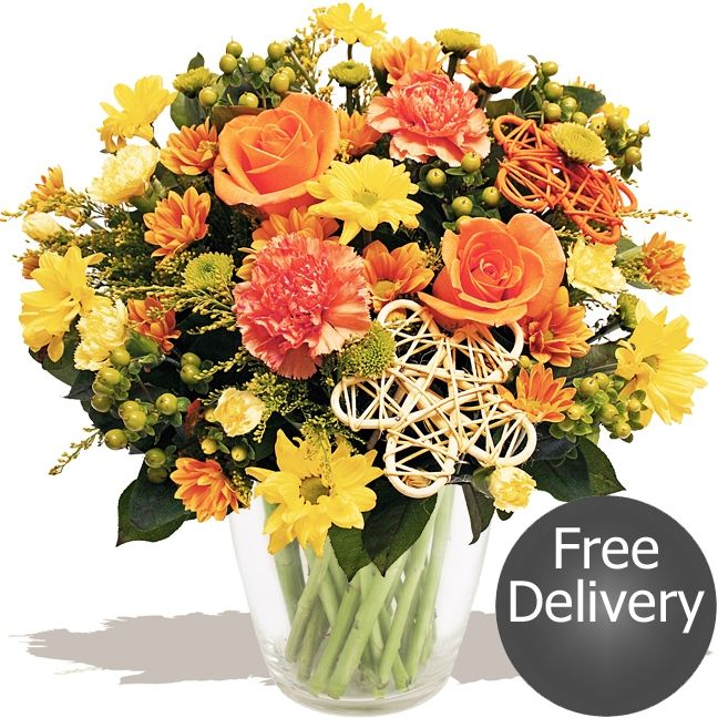 Falling Leaves  An beautiful autumn bouquet, handmade by our expert florists using bright orange Roses, saffron yellow Solidago flower, orange Carnations & Spray Carnations with trendy lime green Santini flower, fresh Chrysanthemums, plump Hypericum berries and finished with wicker flower decorations. A popular autumnal choice that's sure to delight.