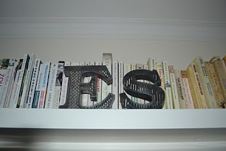 My living room: Metal font letters from Urban Outfitters. http://motheach.blogspot.com