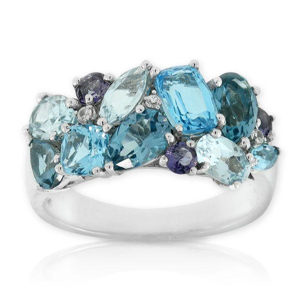 Multi-shape gemstone ring in 14K white gold. Gemstones are blue topaz, iolite and white sapphires.