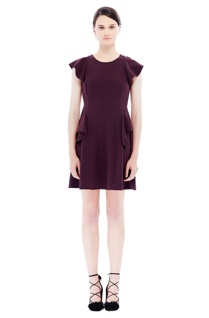 This crepe fit and flare dress gets some feminine definition from flutter sleeves and ruffling along the body.