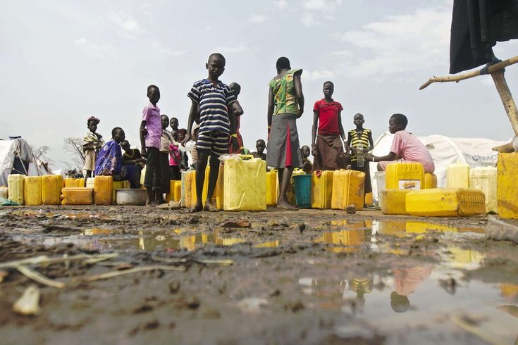 Isaac Kasamani/Agence France-Presse/Getty Images WATERING HOLE: South Sudan refugees fetched water at a refugee center in Adjumani, Uganda, Friday. Refugees from the war-torn country are flooding into Uganda.