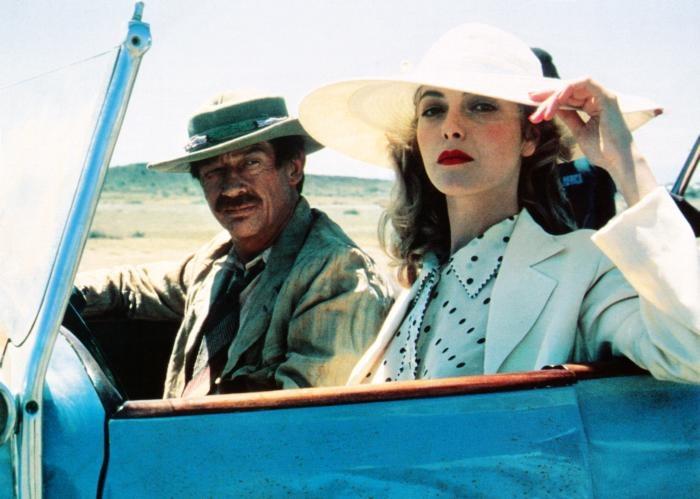 WHITE MISCHIEF, from left: John Hurt, Greta Scacchi, 1988.