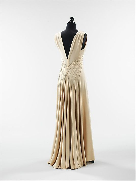 """Diamond Horseshoe""""  Elizabeth Hawes (American, 1903–1971)  Date: fall/winter 1936–37 Culture: American Medium: silk, metal Dimensions: Length at CB: 57 in. (144.8 cm) Credit Line: Brooklyn Museum Costume Collection at The Metropolitan Museum of Art, Gift of the Brooklyn Museum, 2009;"""