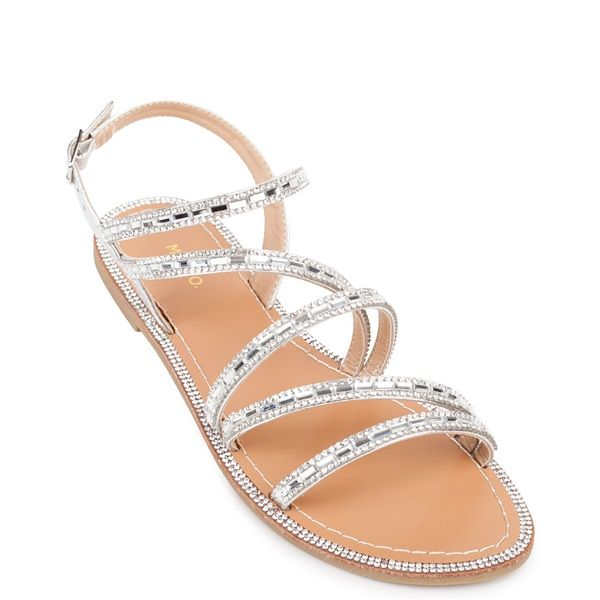 Silver metallic flat sandal with multistraps decorated with rhinestones. Fastens with adjustable slingback strap.