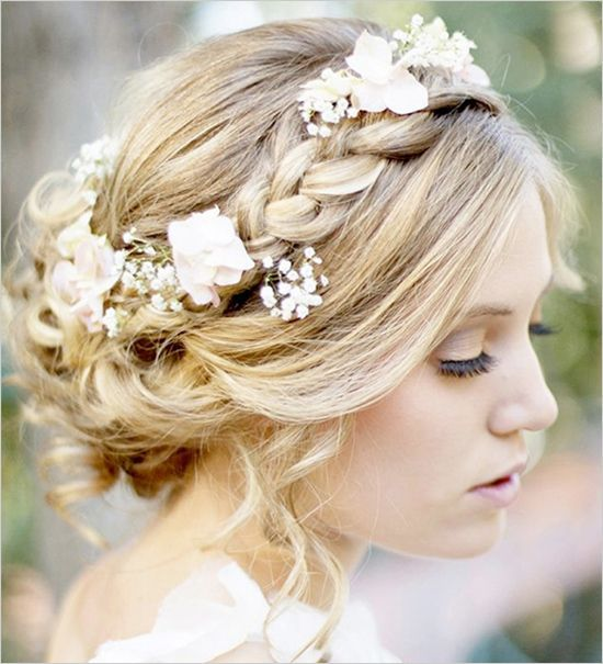 Add flowers to your wedding hair for a soft and natural look. Click to see more braided hair wedding ideas.