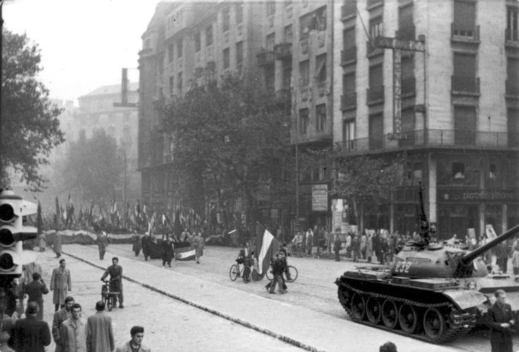 Felvonulók az akkori Tanács körúton #revolution #1956 #hungary #houseofterror #communism #square #redstar #tank #flag