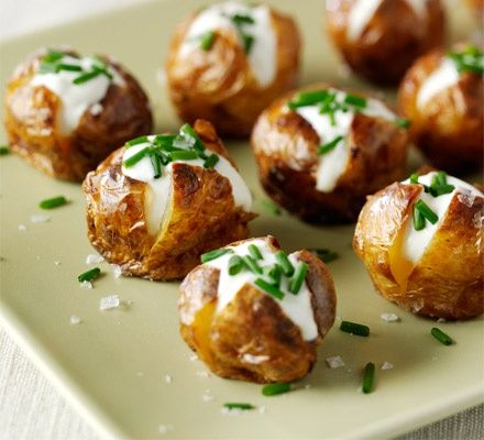 Mini jacket potatoes    Heat oven to 190C/170C fan/gas 5. Prick the potatoes with a fork, rub with the oil, then toss with sea salt. Arrange on a baking sheet and bake for 1 hr. Let the potatoes cool for 10-15 mins, then cut a small cross in the top of each and pinch the bases to open a little. Add a teaspoon of soured cream to each, a little fresh