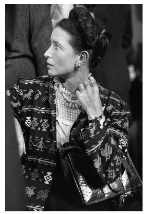 August 2, 1947. Simone de Beauvoir in Paris. (Details of the bag, necklace and coat tissue to be noticed). The photo, by Charles Hewitt, is in the cover of the new English translation of Le Deuxième Sexe.