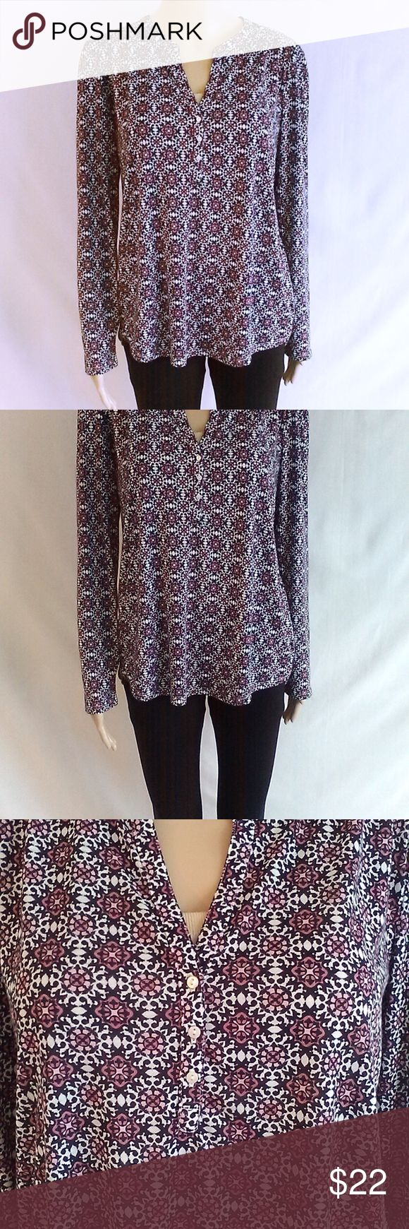 H&M Long Sleeve Blouse Adorable H&M long sleeve Blouse.  V neck w/ 3 small vertical buttons at the bust Blue, pink, black & white pattern  Size medium  Lightweight, breathable, and comfortable fabric.  In great condition, no flaws.  Mannequin is wearing a nude bandeau, which you can see peaking thru at the v neck this is not part of the top or included in sale.  Make an offer or bundle & save!! H&M Tops Blouses