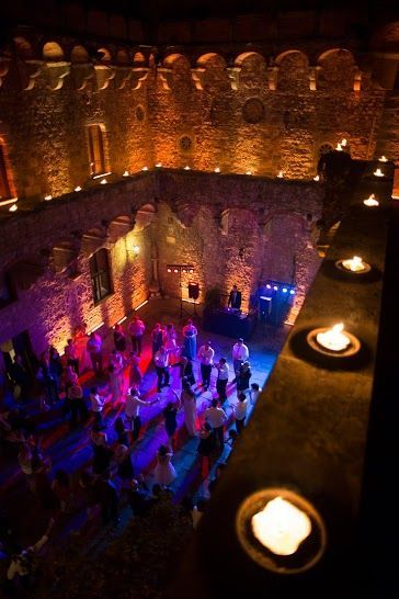 LED lighting for the dance area and cintronella torch candles at our Castello Vincigliata wedding @alma