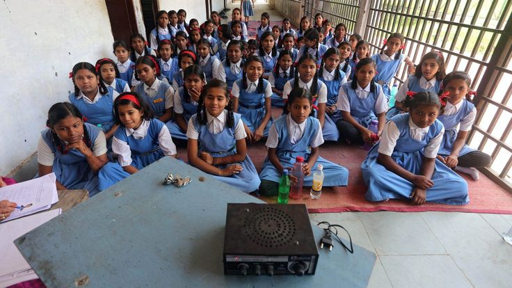 epaselect epa04912239 Indian pupils listen to a radio broadcast of a speech marking Teachers' Day at a school in Bhopal, India, 04 September 2015. Teachers' Day commemorates  the birthday of Sarvepalli Radhakhrishnan, the second President of India who as both a teacher and philosopher made a significant contribution towards the Indian education system, and is observed on the 05 September throughout India since 1962.
