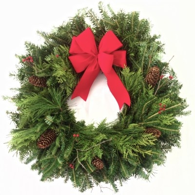 'The Natural' Christmas Wreath is made of arborvitae, fraser fir, and pine greenery. Decorated with pine cones, real berries, and a red bow. This wreath is a standard door size.