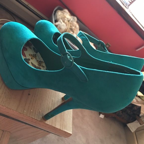 Turquoise heels Velvet turquoise heels. Never worn before but somehow they have 2 small yellow stains on the heel Shoes Heels