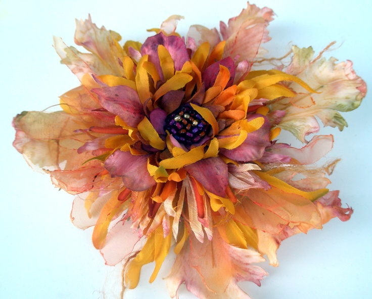 fiberluscious - Tutorials manipulating fabric flowers ** lovely site ** wonderful tutorials on makeing pin cushions too!