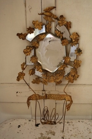 use gold leaves and wire and put around any shape mirror