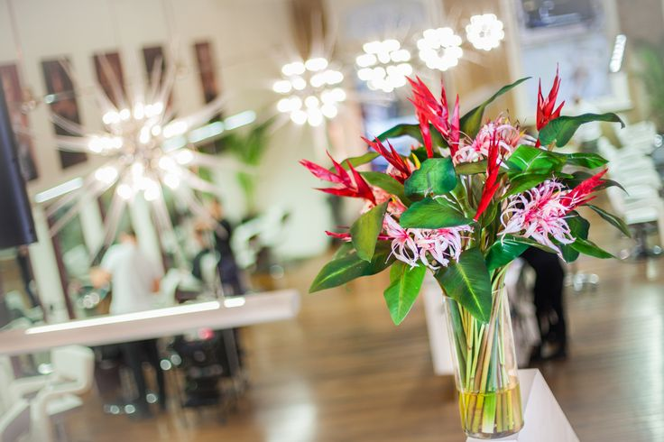 Heliconia and spider lily arrangement by Floral Instinct