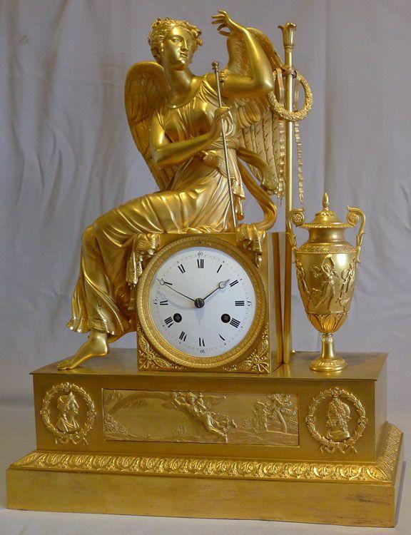 Antique French Empire ormolu mantel clock of winged goddess