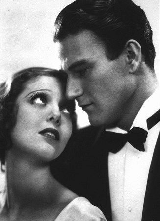 """Three Girls Lost"" (1930) John Wayne as Gordon Wales, And Loretta Young as Norene McMann"